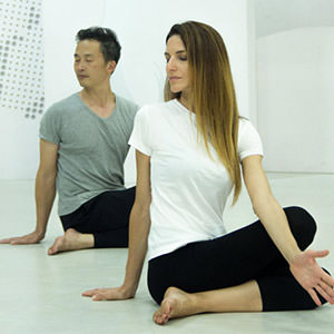 A man and woman are practicing Heartfulness Yoga