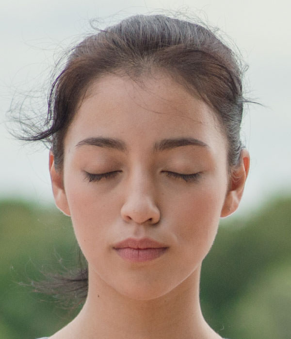A girl is Practicing Heartfulness meditation