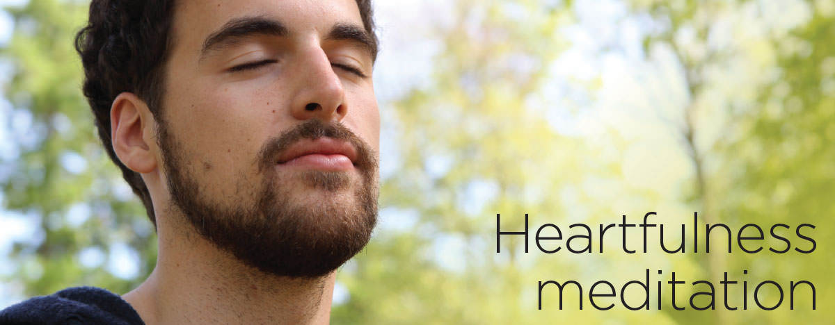 A young man is practicing Heartfulness meditation
